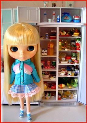 Priscilla-Ann showing you the refrigerator
