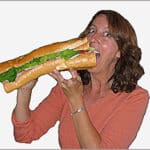 Sister Eating Big Sandwich