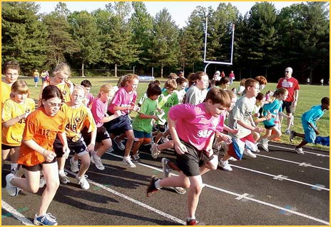 Kids run on the track