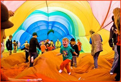 Kids play inside a hot air balloon