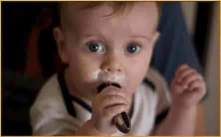 Baby feeds himself