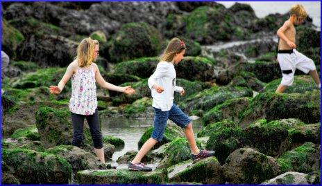 children climbing over the rocks