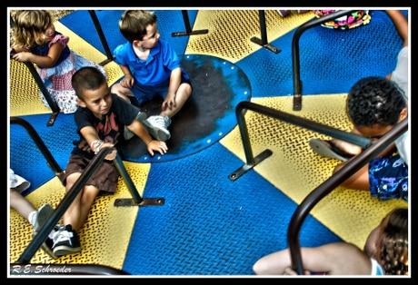 children on park merry-go-round