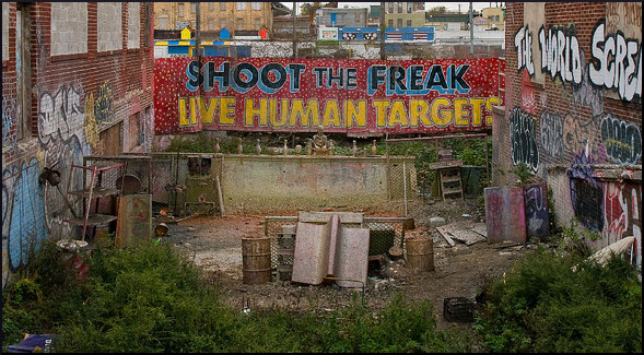 "old sideshow sign: ""shoot the freak, live human targets"""