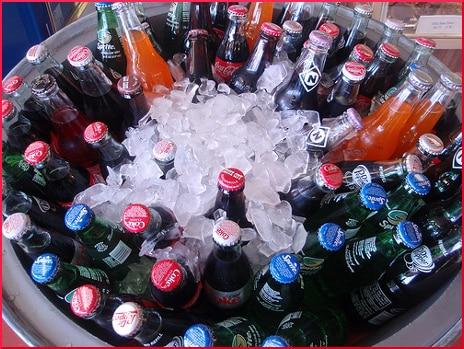 cooler of soda pop bottles