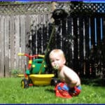 [little boy playing in back yard]
