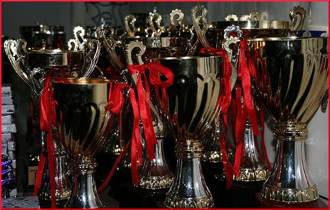 [row of trophies]