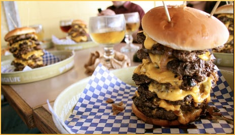 [cheeseburgers stacked with five or six patties]