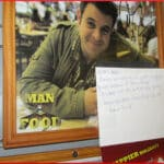 [photo of Adam Richman on a restaurant wall]