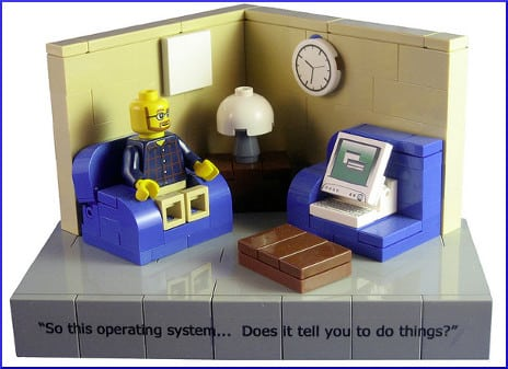 "[plastic toy man speaking to computer: ""So this operating system... Does it tell you to do things?""]]"