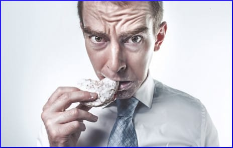 guy-eating-a-donut
