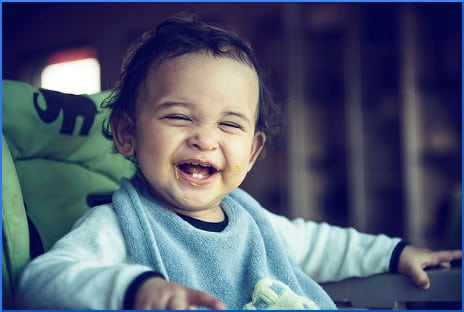 kid-in-high-chair-laughing