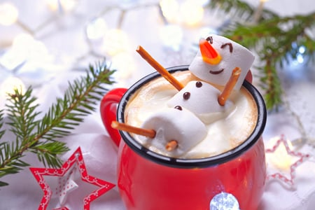 48603214 - red mug with hot chocolate with melted marshmallow snowman