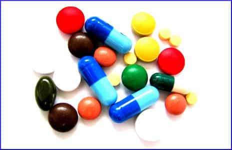 colorful-pills-white-background