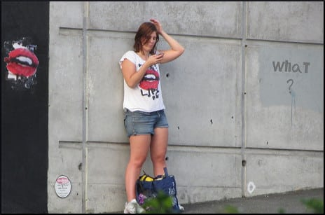 person-on-phone-against-the-wall