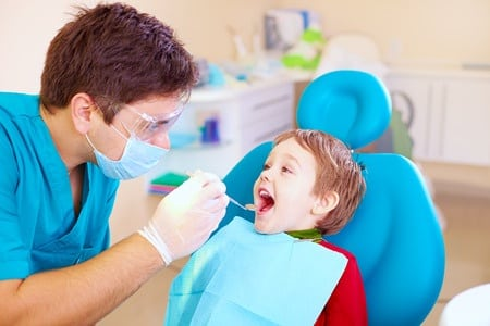 dentist with kid patient