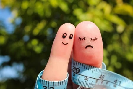 finger art of couple with meter