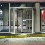 revolving-door-yellow-tape
