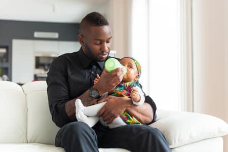 father-feeding-baby