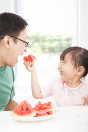 girl-feeding-dad-watermelon