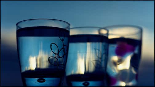 three-blue-water-glasses