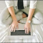 woman-on-bed-with-laptop